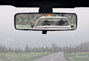 Monoprint showing a car windshield in rain and police car in rear mirror