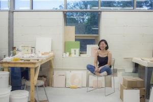 person sitting in ceramic studio