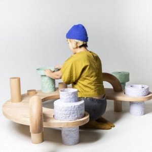 person seated at experimental communal table