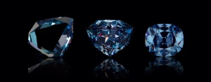 Three various cuts of the Hope Diamond through history. Large blue gems with different shapes.